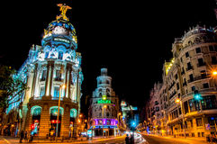 Madrid, Spain - June 3, 2013: Night view of the street Grand Via and Metropolis hotel  building in Madrid Royalty Free Stock Photos