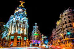 Madrid, Spain - June 3, 2013: Night view of the street Grand Via and Metropolis hotel  building in Madrid Royalty Free Stock Image