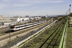 MADRID, SPAIN - MAR 01: Renfe local train going by Torrejon de A Royalty Free Stock Images