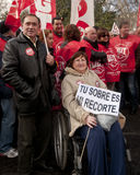 Wheelchair lady in Madrid demonstration. MADRID SPAIN - MARCH 10: Demonstration taking place in central Madrid against the cuts in education, social benefits Royalty Free Stock Photography