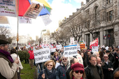 Demonstrators pass by the Bank of Spain Stock Photos