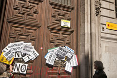 Placards on the Ministry of Finance door in Madrid. MADRID SPAIN - MARCH 10: Demonstration taking place in central Madrid against the cuts in education, social Stock Image