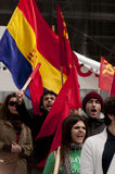 Communist demonstrators waving flags and chanting Royalty Free Stock Image