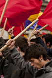 Communist demonstrators waving flags and chanting. MADRID SPAIN - MARCH 10: Demonstration taking place in central Madrid against the cuts in education, social Royalty Free Stock Photos