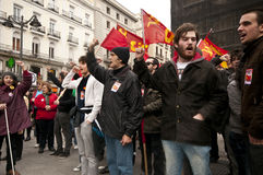 Singing Communist Party demonstrators Stock Photo