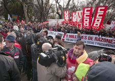TV cameras and demonstrators. MADRID SPAIN - MARCH 10: Demonstration taking place in Madrid against cuts  that have been imposed due to the economic crisis. TV Royalty Free Stock Photography