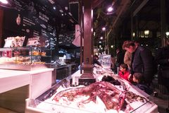 Evening market of San Miguel serving customers. MADRID, SPAIN - 28 MARCH, 2018: Evening market of San Miguel serving customers Stock Images