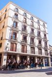 A Residence Building. Madrid, Spain - March 11, 2015: Men and women in ceremonial uniform, mounted on horseback stand outside a residential building in central stock photo