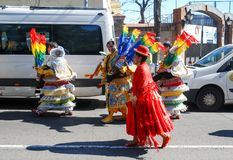 Madrid, Spain, March 2nd 2019: Carnival celebration, members of Bolivian dance group walking after the parade with traditional stock images