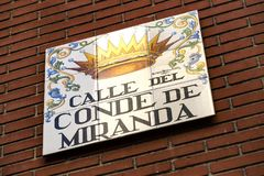 Signs of street names are created from ceramic tiles with a picture illustrating the name of the street. MADRID, SPAIN - 27 MARCH, 2018: Signs of street names Royalty Free Stock Photography
