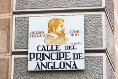 Signs of street names are created from ceramic tiles with a picture illustrating the name of the street. MADRID, SPAIN - 27 MARCH, 2018: Signs of street names Stock Images