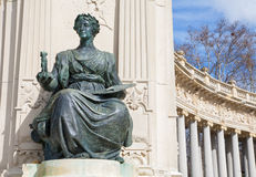 MADRID, SPAIN - MARCH 9, 2013: Statue of Athena goddess of art in side part of the Monument of Alfonso XII in Buen Retiro park Stock Images