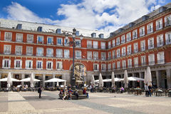 MADRID, SPAIN - MAY 28, 2014: cafe on Plaza Mayor and Statue of Philip III in foront of his house Stock Photos