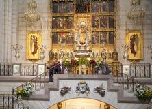 MADRID, SPAIN - MAY 28, 2014: Golden altar in Santa Maria la Real de La Almudena cathedral, Madrid, Spain. Stock Photos