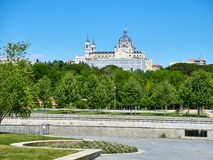 Green spaces of Madrid Rio with the Almudena Cathedral in background. Royalty Free Stock Photo