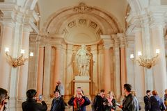Tourists enjoy sightseeing at the Royal Palace of Madrid, Spain. stock images