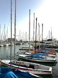 Beautiful yacht ship moored at port with other boats on blue salted sea stock photos