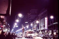 MADRID, SPAIN: NIGHT SHOT OF `LA AVENIDA DE JOSE ANTONIO` a.k.a. `LA GRAN VIA,` MADRID`S MAIN STREET IN DECEMBER, 1966 Royalty Free Stock Photo