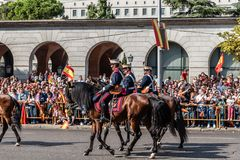 Cavalry marching in Spanish National Day Army Parade. Madrid, Spain - October 12, 2017: Calvary marching in Spanish National Day Army Parade. Several troops take Royalty Free Stock Photos