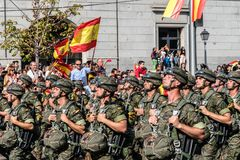 Paratroopers marching in Spanish National Day Army Parade. Madrid, Spain - October 12, 2017: Paratroopers marching in Spanish National Day Army Parade. Several Stock Photography