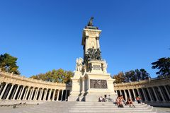 Madrid monument. MADRID, SPAIN - OCTOBER 23, 2012: People visit Monument to Alfonso XII in Madrid. The royal memorial located in Buen Retiro Park was designed by Royalty Free Stock Photography
