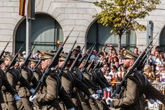 Soldiers marching in Spanish National Day Army Parade. Madrid, Spain - October 12, 2017: Soldiers marching in Spanish National Day Army Parade. Several troops Stock Image