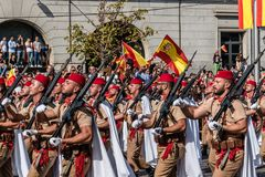 Soldiers marching in Spanish National Day Army Parade. Madrid, Spain - October 12, 2017: Soldiers marching in Spanish National Day Army Parade. Several troops Royalty Free Stock Images