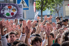 Madrid, Spain - October 26, 2016 - Students keeping hands up at protest against education politics in Madrid. Students keeping hands up at protest against Royalty Free Stock Images