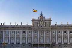 Madrid, Spain Royal Palace facade with Spanish flag waving. External view of Palacio Real de Madrid in the Spanish capital, official residence of the Spanish Royalty Free Stock Photography