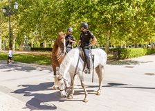 MADRID, SPAIN-SEPTEMBER 11, 2015: Horse police patrol the street Royalty Free Stock Photography