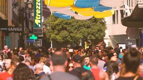 MADRID, SPAIN - SEPTEMBER 30, 2018. Overhead telephoto lens shot of a crowded tourist street in city centre. MADRID, SPAIN - SEPTEMBER 30, 2018. Overhead stock photos