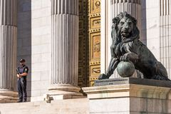 MADRID, SPAIN - SEPTEMBER 26, 2017: Statue of a lion Congress of Deputies. Copy space for text. stock photography