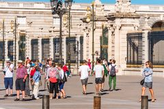 MADRID, SPAIN - SEPTEMBER 26, 2017: Tourists near the building of the Royal Palace building. Copy space for text. stock photography