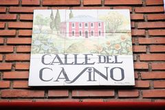 Madrid street sign. MADRID, SPAIN - OCTOBER 24, 2012: Calle del Casino typical street sign in Madrid, Spain. Artistic ceramic tile signs are typical for Madrid stock photo