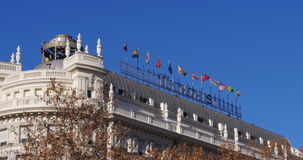 Madrid sunny day hotel roof top waving flags 4k spain stock footage