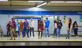 Madrid, Tube, underground station with commuters awaiting train Royalty Free Stock Photos