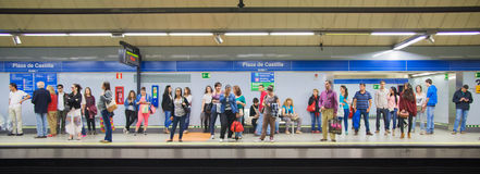 Madrid, Tube, underground station with commuters awaiting train. MADRID, SPAIN - MAY 28, 2014: Tube, underground station with commuters awaiting train Royalty Free Stock Photo