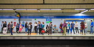 Madrid, Tube, underground station with commuters awaiting train. MADRID, SPAIN - MAY 28, 2014: Tube, underground station with commuters awaiting train Stock Image