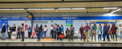 Madrid, Tube, underground station with commuters awaiting train Royalty Free Stock Image