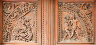 Madrid - Wooden relief expulsion of Adam and Eva from Paradise scene Stock Photography
