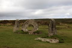 United Kingdom. Madron England, UK - August 16, 2015: A tourist near The famous Mên-an-Tol a Megalithic stone and Tomb near Madron, West Penwith, Cornwall stock photo