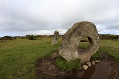 United Kingdom. Madron England, UK - August 16, 2015: A tourist near The famous Mên-an-Tol a Megalithic stone and Tomb near Madron, West Penwith, Cornwall stock photography