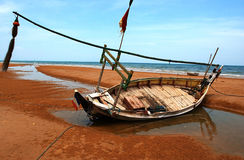 Madura. Fishing boats leaning on the Slopeng beach Madura, East Java Royalty Free Stock Image
