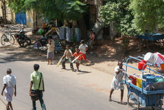 Madurai Street Scene. Boys play cricket in the street in Madurai Stock Photography