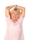 Madure estirar de una más vieja señora Fotos de archivo libres de regalías