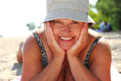Madure la playa de la mujer Fotografía de archivo