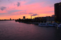 Nieuwe Maas (New Meuse) river and cityscape in twilight panorama in Rotterdam, Netherlands. Stock Photography