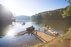 MAE HONG SON, THAILAND - JANUARY 1, 2016: Bamboo rafting tourist. S to appreciate the atmosphere surrounding the reservoir at Pang Ung on January 1, 2016, Mae royalty free stock images