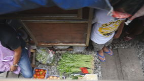 Mae Klong railway market. Samut Songkhram, Thailand-October 6, 2016: Whenever a train approaches, the awnings and shop fronts are moved back from the rails, to stock video footage