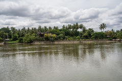 The Mae Klong river in Thailand. The Mae Klong is a river in western Thailand that begins at the confluence of the Khwae Noi and the Khwae Yai River in stock images